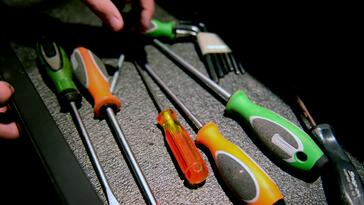 Automotive enthusiast choosing a screwdriver from his toolbox for a DIY project