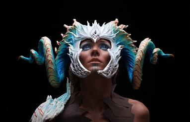 Cosplay maker wearing an intricate horned headpiece made from innovative cosplay supplies and products
