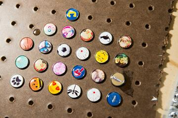 Board covered in domed resin jewelry snap buttons