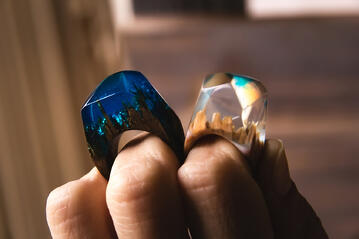 Wood and resin jewelry rings made in a mold