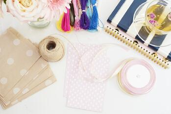 Scrapbooking and paper crafting supplies on a white table