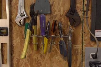 Master woodworking tools hanging on the wall in a workshop